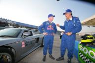 Jay Leno, with instruction from racing driver David Donohue (left), set three speed records in this Carrera GT car. [Courtesy PRNewsFoto]